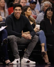 Christian Yelich of the Milwaukee Brewers watches the Bucks game on Monday night.