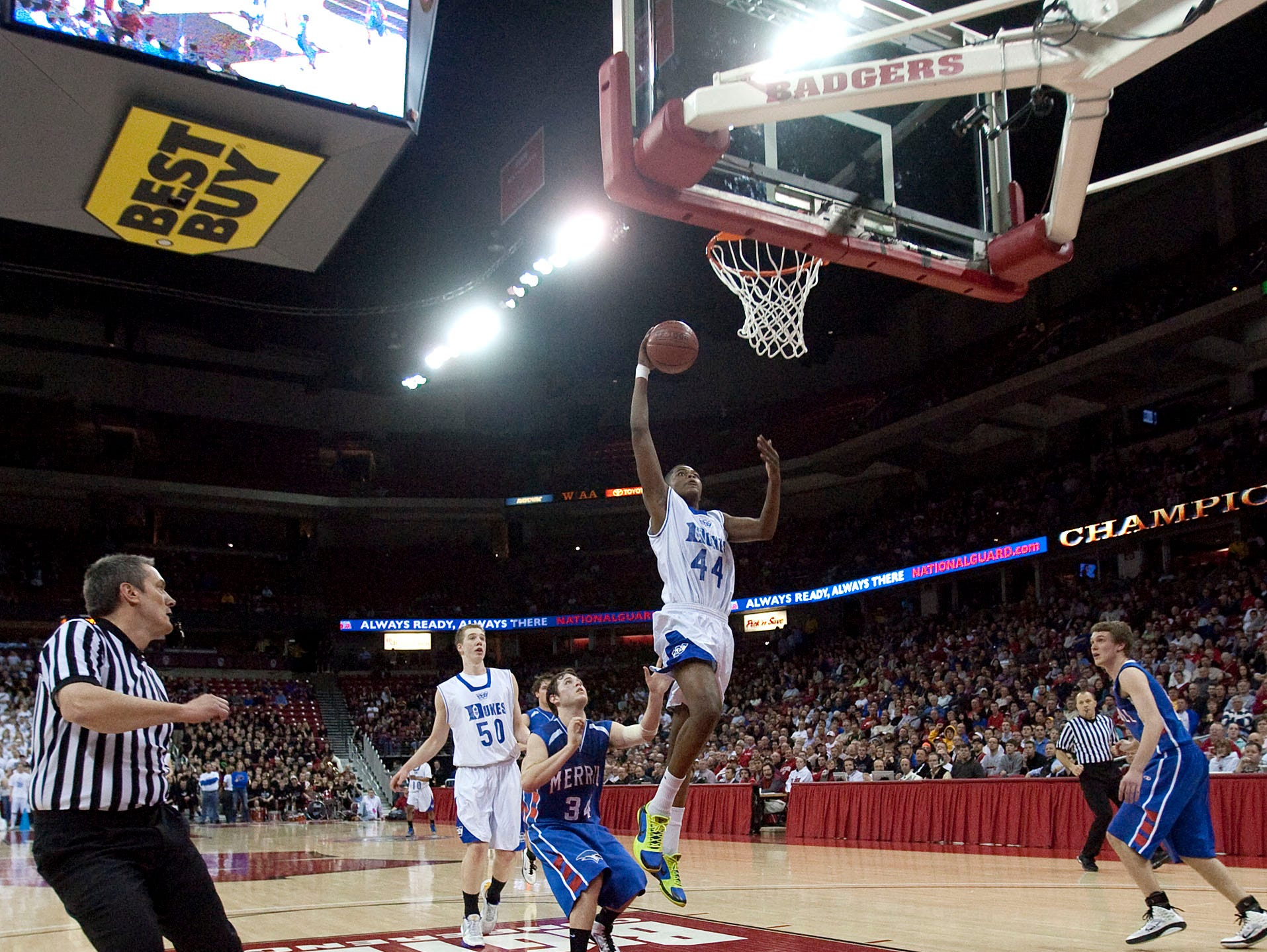 Whitefish Bay's Ron Patten goes up for a slam dunk past Merrill's Kyle Andreska late in the fourth period of the teams W.I.A.A. Boys State Basketball Tournament Championship game in the Kohl Center Saturday, March 19, 2011, in Madison, Wis.  Whitefish Bay won the game 65-49.