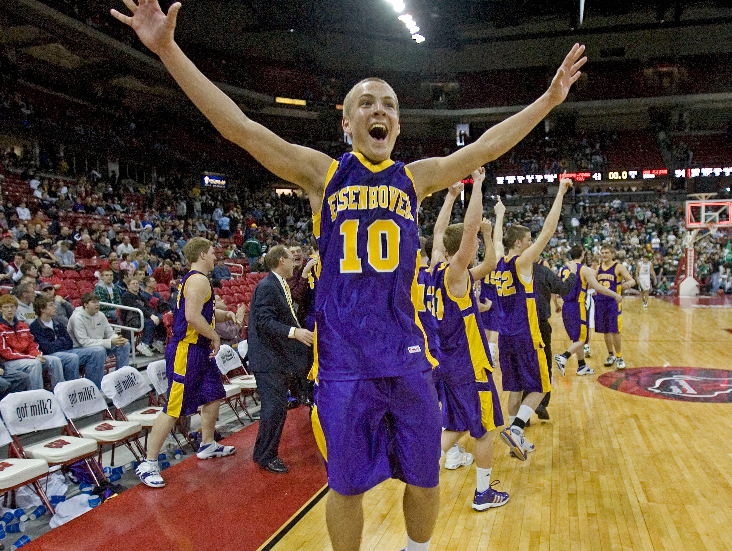 New Berlin Eisenhower's Alex Krzykowski and the rest of the team celebrates their victory over Adams-Friendship 54-41 to win the 2008 WIAA Division 2 championship at the Kohl Center in Madison, WI.