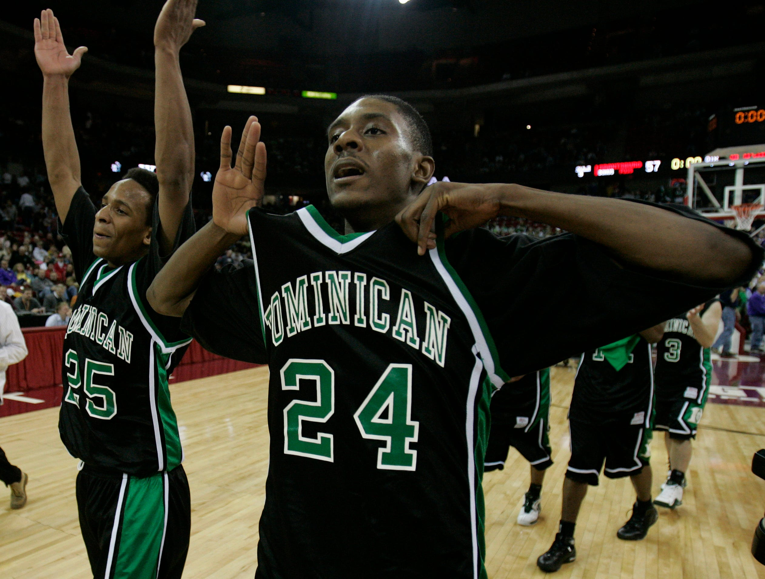 Walter Blount Jr. along with Brandon Brown celebrate Dominican's 2005 Division 3 Win 66-57 over Grantsburg at the Kohl Center Saturday night.