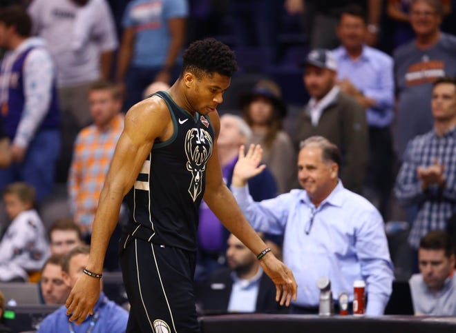 Giannis Antetokounmpo walks off the court Monday night after the Bucks lost to the Suns.