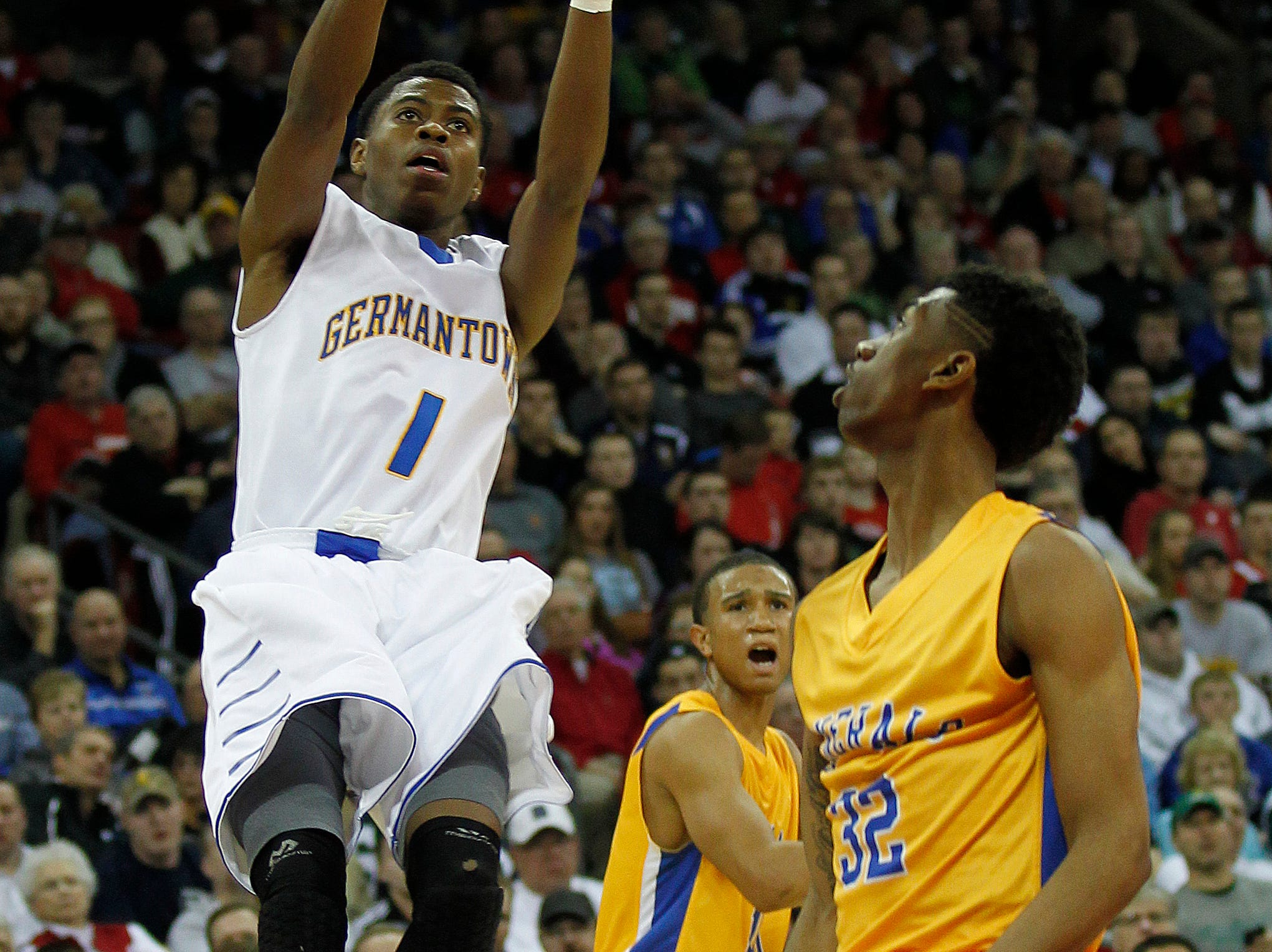 Germantown Warhawks' Lamonte' Bearden goes up for a shot against Milwaukee King Generals' Diamontae Freeman in the third period of the 2014 Division 1 WIAA Boys Basketball Tournament being held at the Kohl Center.
