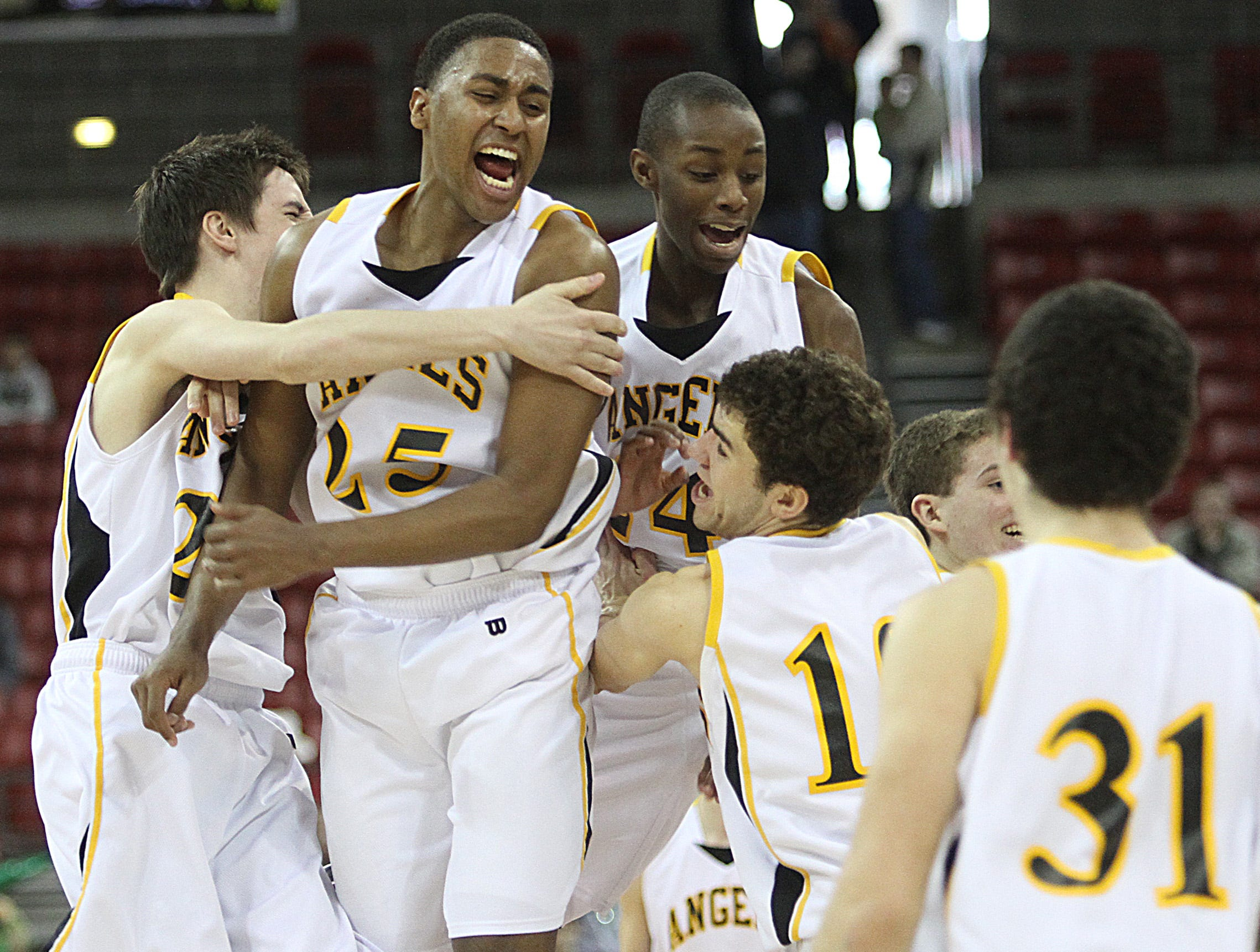 WIAA Division 3 championship game Racine St. Catherine's players #23 Nick Moes #25 Steve McWhorter #24 Antonio Stafford  celebrate their state D3 title on the floor of the Kohl Center.