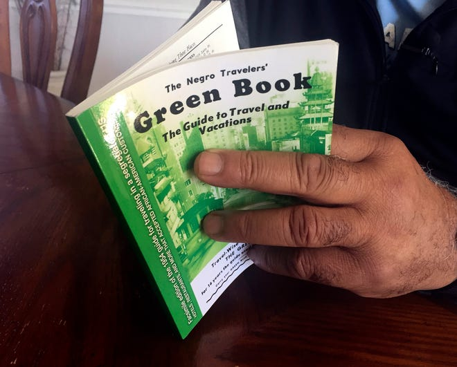 """A copy of the 1954 edition of """"The Negro Travelers' Green Book""""  guidebook that helped black travelers navigate segregated America."""