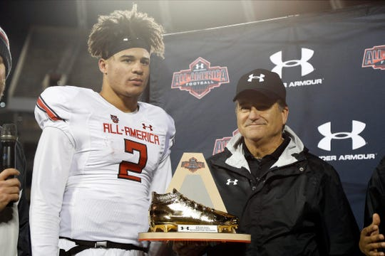 Steve Mariucci presents the MVP trophy to quarterback Joey Gatewood (2) at Camping World Stadium after the Under Armour All-America Game on Jan. 4, 2018, in Orlando, Fla.