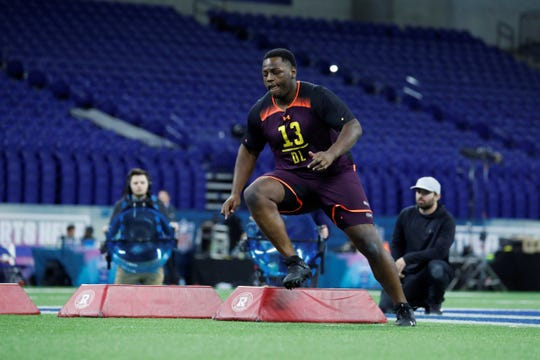 Mar 3, 2019; Indianapolis, IN, USA; Auburn defensive lineman Dontavius Russell (DL13) goes through workout drills during the 2019 NFL Combine at Lucas Oil Stadium. Mandatory Credit: Brian Spurlock-USA TODAY Sports
