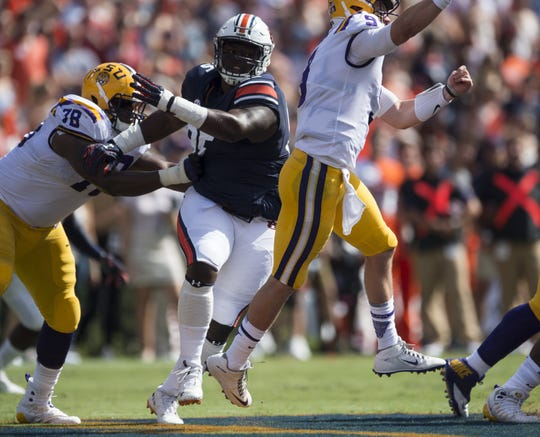 Auburn's Dontavius Russell (95) breaks through the LSU offensive line at Jordan-Hare Stadium in Auburn, Ala., on Saturday, Sept. 15, 2018. LSU defeated Auburn 22-21.