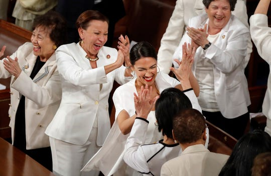 In this file photo from Tuesday, Feb. 5, 2019, women members of the House of Representatives, including Rep. Alexandria Ocasio-Cortez, D-N.Y., center, cheer after President Donald Trump acknowledges more women in Congress during his State of the Union address to a joint session of Congress on Capitol Hill in Washington. From left are House Appropriations Committee Chair Nita Lowey, D-N.Y., House Small Business Committee Chair Nydia Velazquez, D-N.Y., Rep. Alexandria Ocasio-Cortez, D-N.Y., and Rep. Lois Frankel, D-Fla. (AP Photo/J. Scott Applewhite, file)