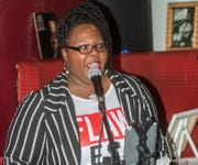 Alicia Purnell sings during a Valentine's Day   poetry and painting night at A Touch of Soul Cafe in Montgomery.