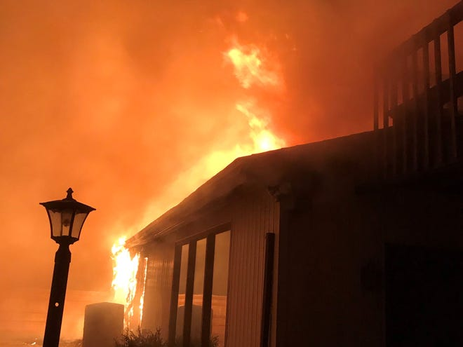 Firefighters battled a house fire in the early-morning hours Tuesday, March 5, 2019.
