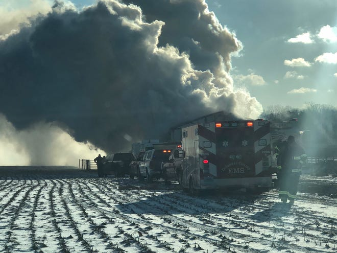 Volunteer firefighters from four departments on Tuesday morning were battling a barn blaze in the 5000 block of North Nebo Road.