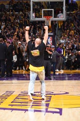 Logan Thomas celebrates with the crowd following his halfcourt shot at the Los Angeles Lakers game on March 1.