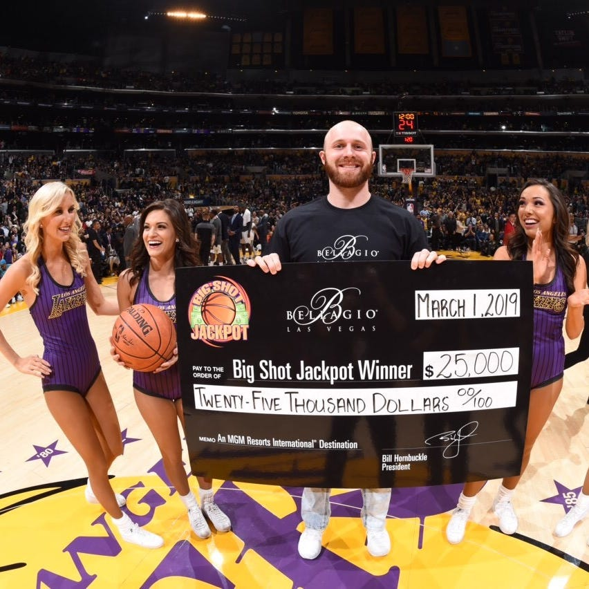 Former ECI star sinks halfcourt shot for $25k at Los Angeles Lakers game