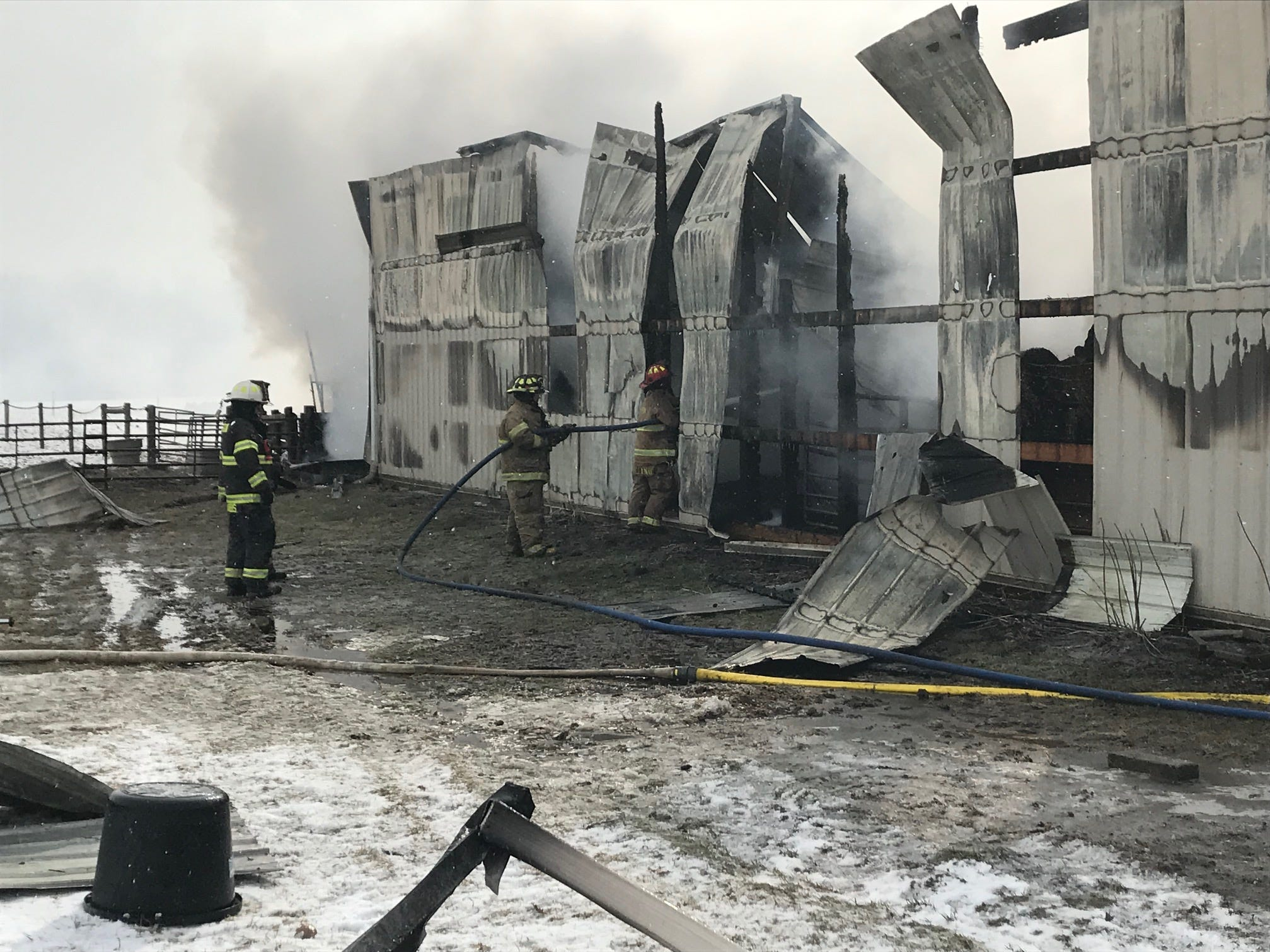 Firefighters work to control a barn fire Tuesday, March 5, 2019.
