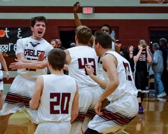 Eagleville players celebrate during Monday's Class A sectional win over Monterey.