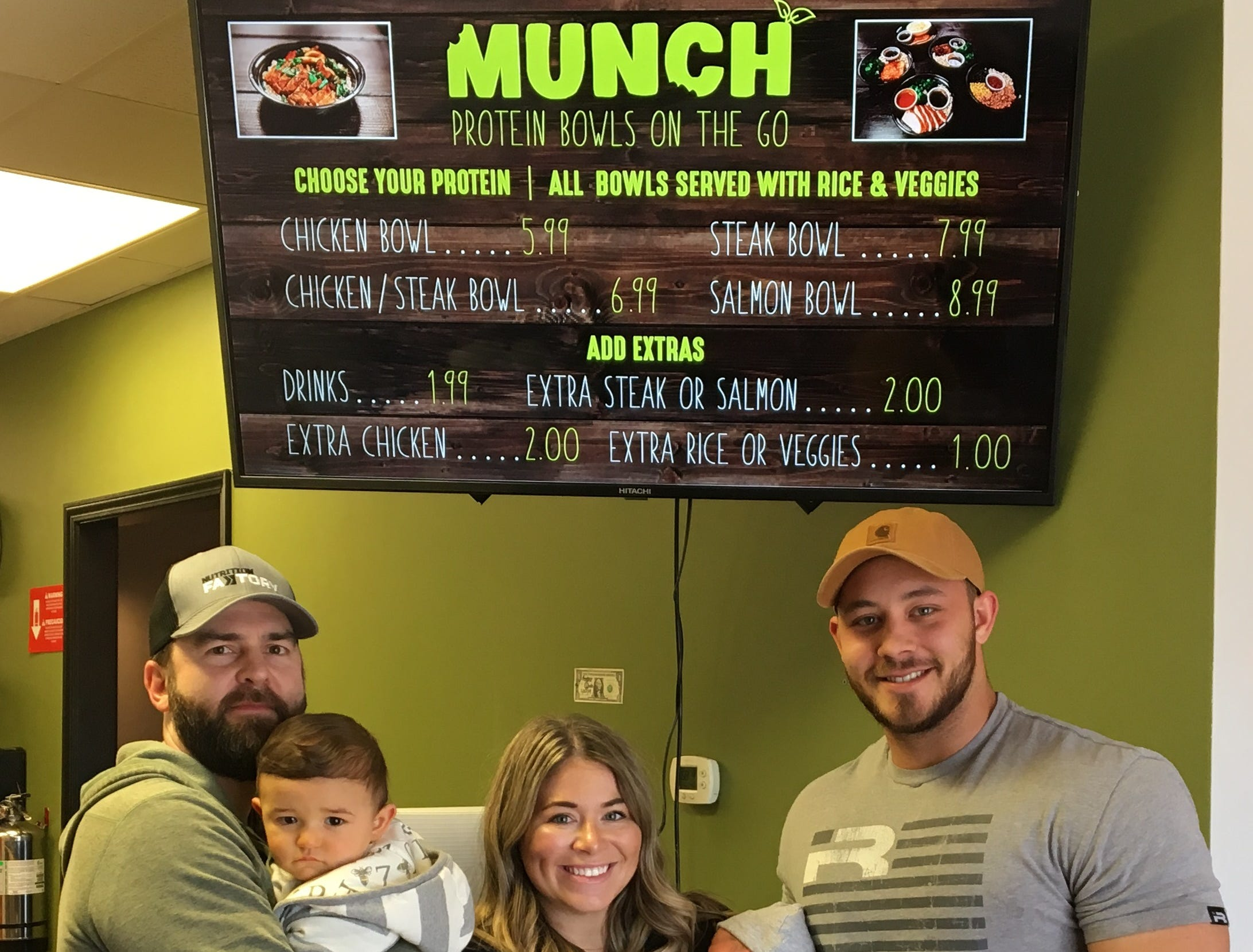 Getting ready for the opening of Munch Murfreesboro, a restaurant that serves fast healthy meals, are, from left, Mike Bires holding son James, and Julia and Ian Mitzelfeld with Ella and Asher.