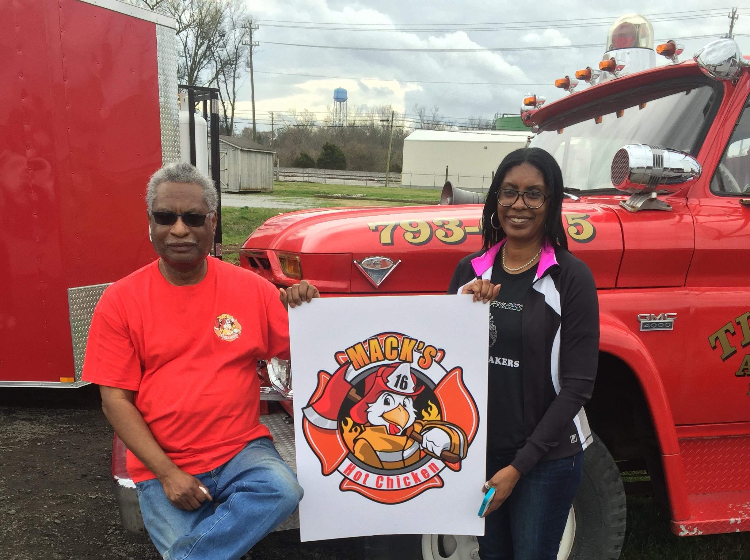 Mack Holt, left, the inspiration for Mack's Hot Chicken, is a 38-year veteran of the Nashville Fire Department. His years as a fireman are represented in the logo, held by daughter, Raychelle Lowe.