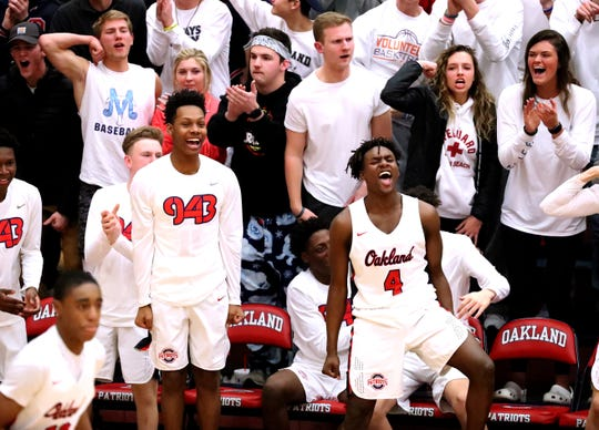 The Oakland bench reacts late in the game against the Hamilton East during the sectional game on Monday, March 4, 2019.