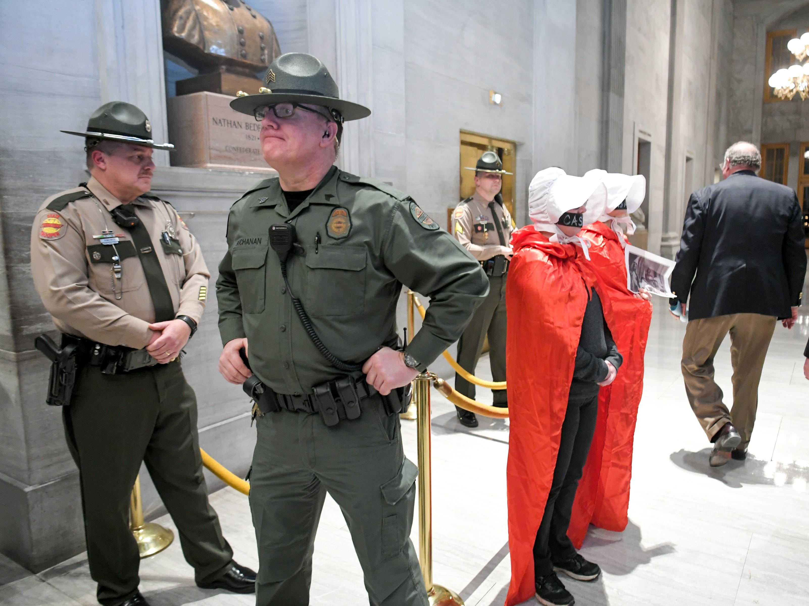 "Dressed as ""Handmaids"" people protest Gov. Bill Lee after his first State of the State address before a joint session of the Tennessee General Assembly inside the House chambers at the state Capitol in Nashville on Monday, March 4, 2019."