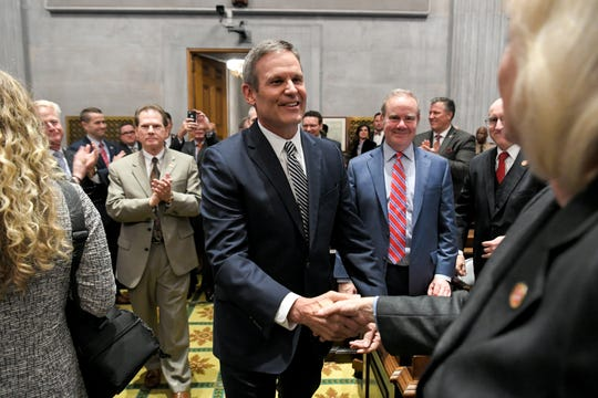 Gov. Bill Lee shakes hands before his first State of the State address before a joint session of the Tennessee General Assembly inside the House chambers at the state Capitol in Nashville on Monday, March 4, 2019.