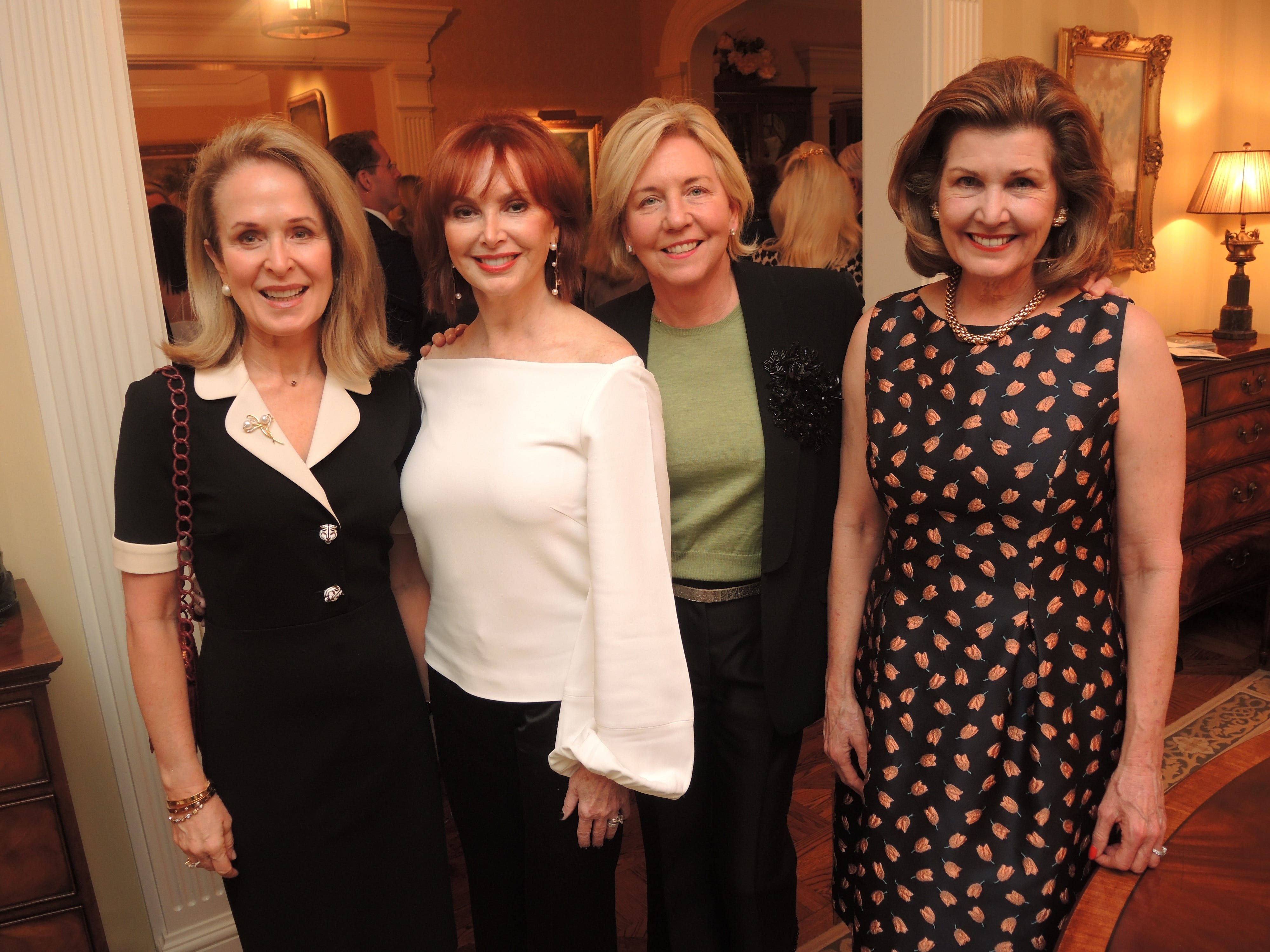 Lisa Manning, left, Sandra Lipman, Mary Spalding and Laura Niewold at the Swan Ball 2019 Unveiling, held at the home of Kathy and Bobby Rolfe.