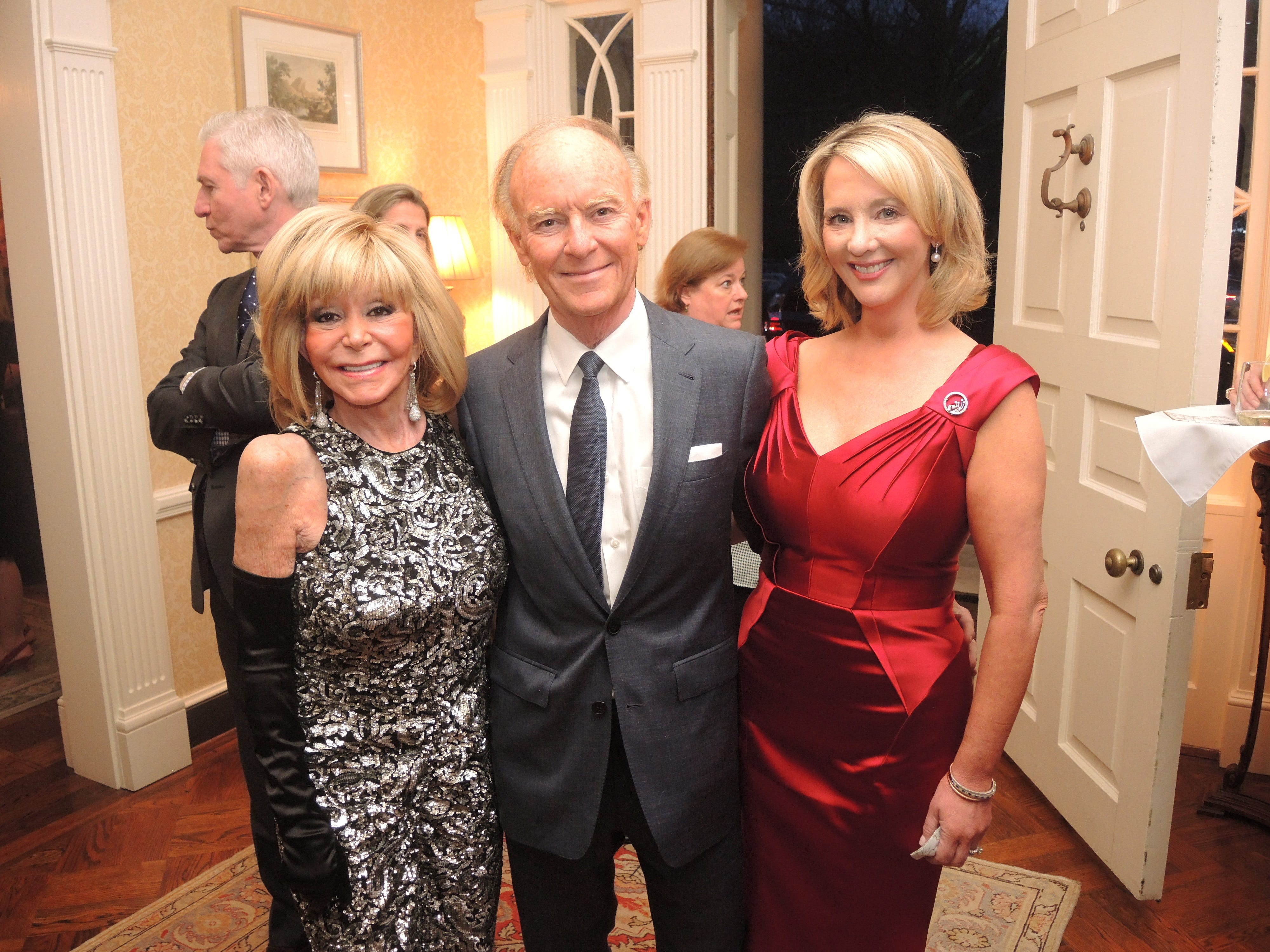 Joyce Vise, left, and Mark and Emily Humphreys at the Swan Ball 2019 Unveiling, held at the home of Kathy and Bobby Rolfe.