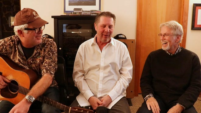 Rivers Rutherford, left, and Tom Shapiro, right, talk with Bart Herbison about songwriting.