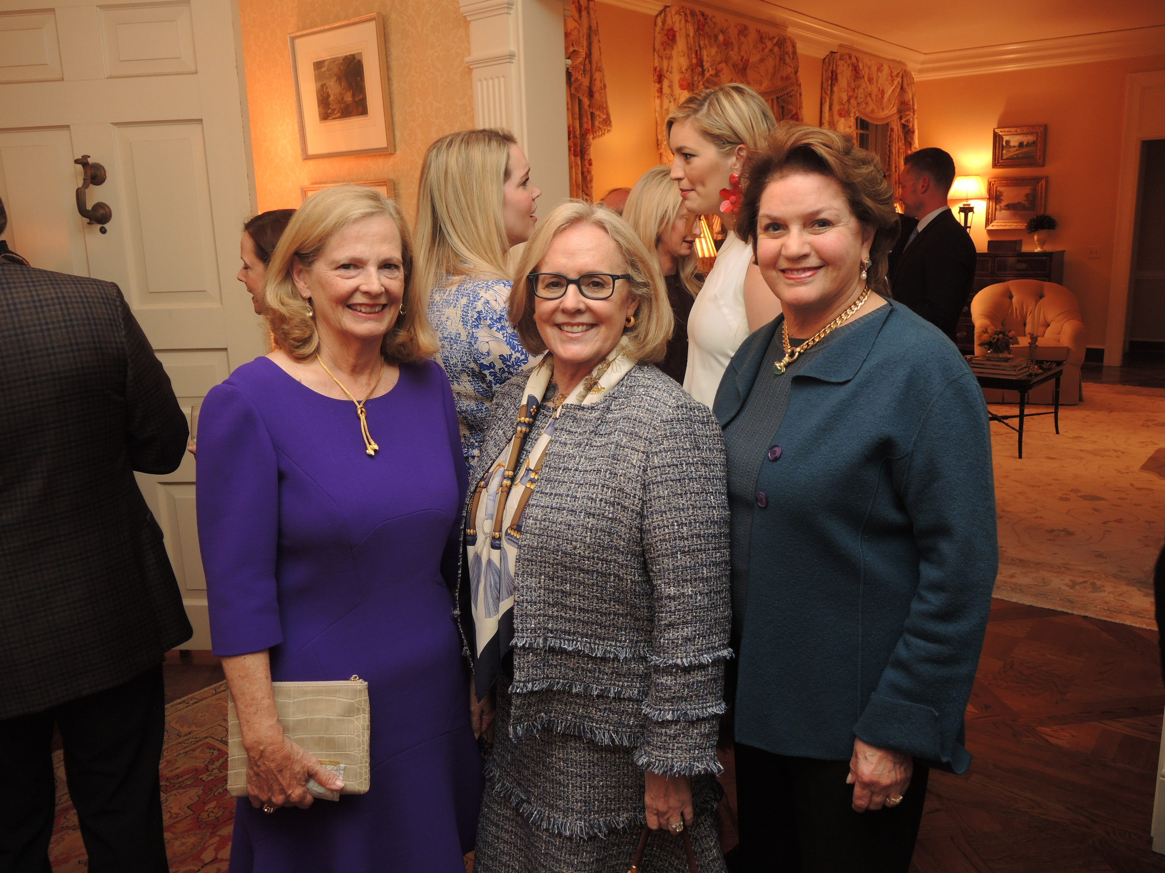 Jean Ann Banker, left, Emily Noel and Jane Coble at the Swan Ball 2019 Unveiling, held at the home of Kathy and Bobby Rolfe.