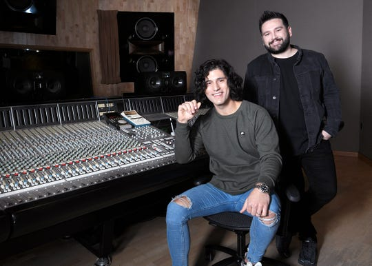 Dan Smyers, left, and Shay Mooney of Dan + Shay work March 4, 2019, in a Music Row recording studio in Nashville.
