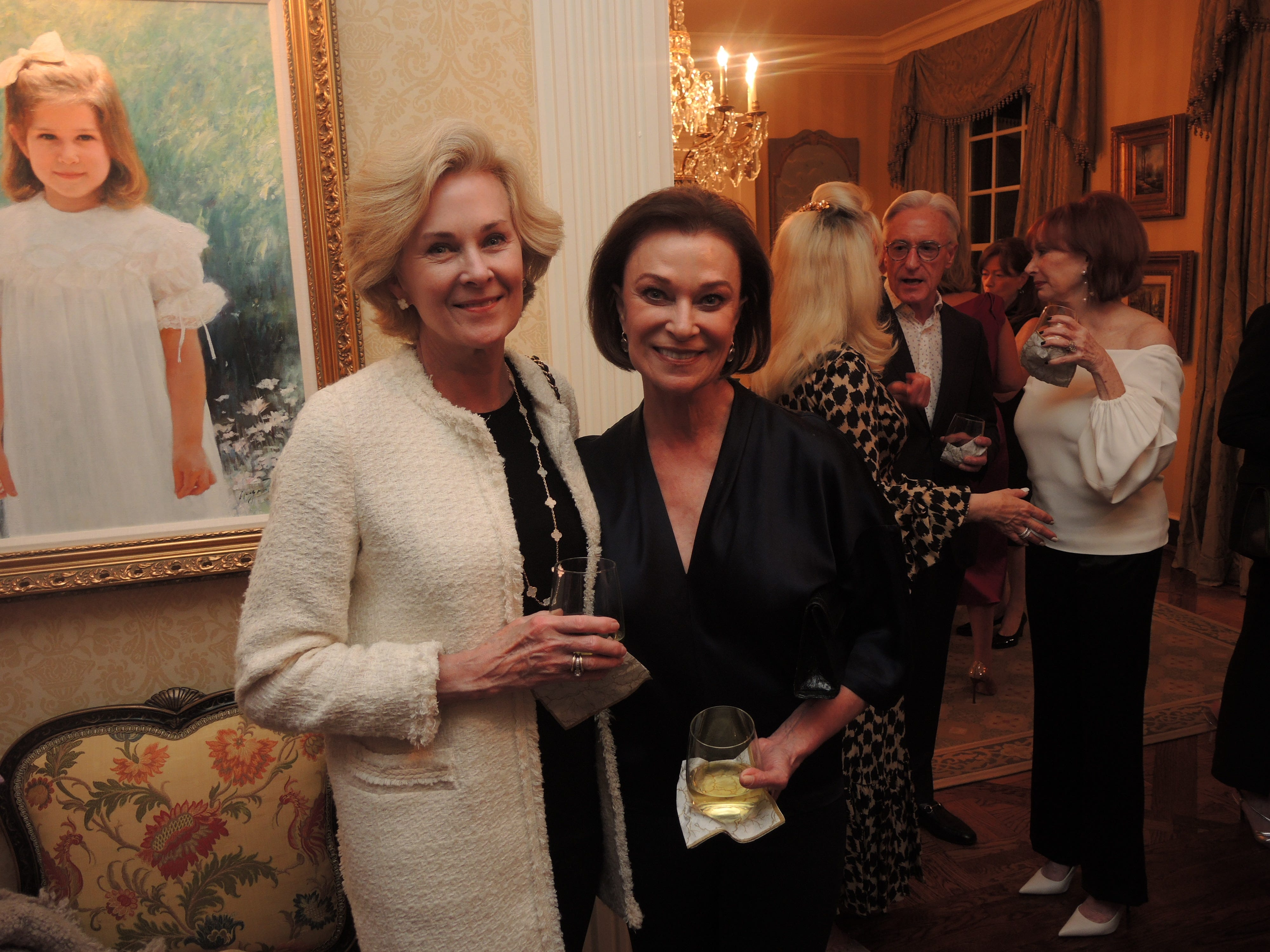 Jenny McCabe, left, and Peggy Kinnard at the Swan Ball 2019 Unveiling, held at the home of Kathy and Bobby Rolfe.