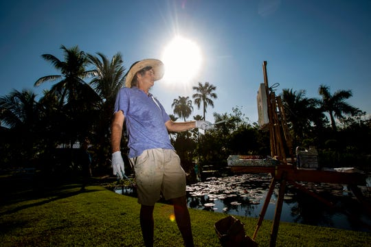 Paul Arsenault works on a painting, Tuesday, March 5, 2019, at the Naples Botanical Garden.