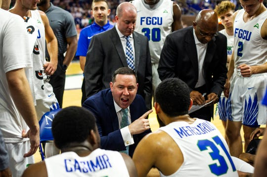 Florida Gulf Coast University head coach Michael Fly, shown talking to his team during the ASUN tournament loss to NJIT, went 14-18 in his first season, and begins his second Tuesday night at Saint Louis.