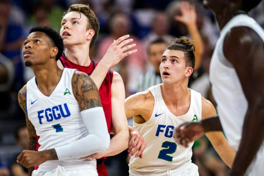 Florida Gulf Coast University's Caleb Catto watches for a rebound during a ASUN quarterfinal against NJIT at Alico Arena on Monday.