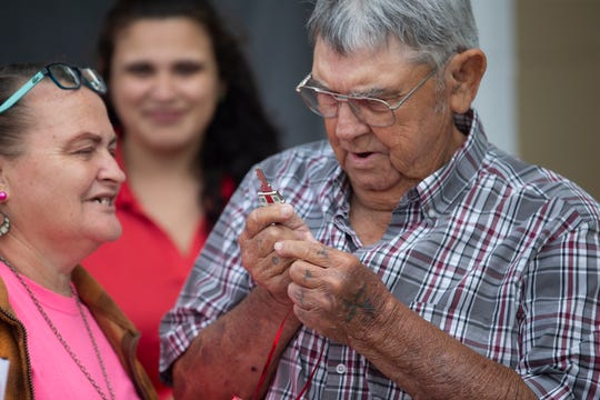 Elizabeth and Earl Bishop look over the key for their newly restored home Tuesday, March 5, 2019, during a dedication and ribbon-cutting in Immokalee.