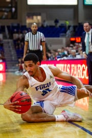 Florida Gulf Coast University's Dinero Mercurius tries to save the ball during a ASUN quarterfinal against NJIT at Alico Arena in Fort Myers, Fla., on Monday, March 4, 2019.