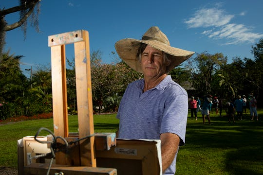 Paul Arsenault paints a scene, Tuesday, March 5, 2019, at the Naples Botanical Garden.