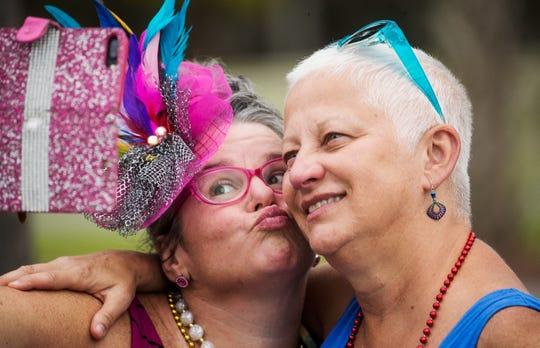 Friends Lisa Henkel, left, and Kim Smith take a selfie while watching the 35th annual Mardi Gras parade at Citrus Park in Bonita Springs on Tuesday 3/5/2019.
