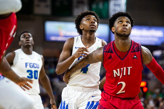 Florida Gulf Coast University's Zach Scott watches for a rebound during a ASUN quarterfinal against NJIT at Alico Arena in Fort Myers, Fla., on Monday, March 4, 2019.