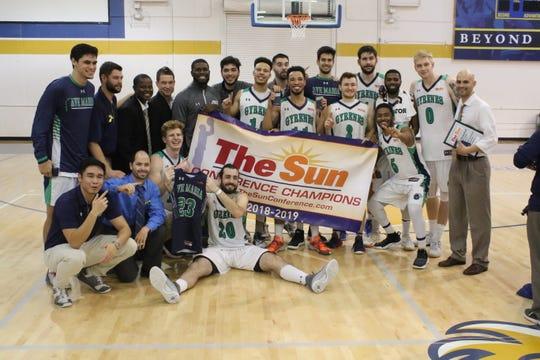 The Ave Maria men's basketball team celebrates The Sun Conference championship Feb. 23.