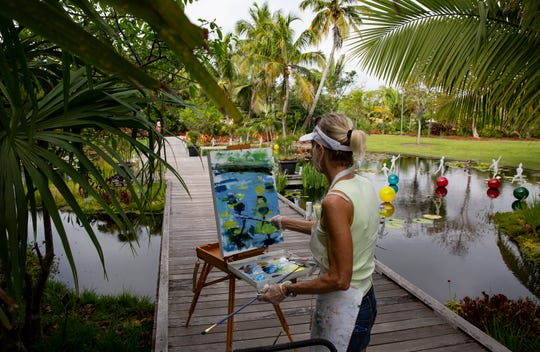 Mary Parkman paints, Tuesday, March 5, 2019, at the Naples Botanical Garden