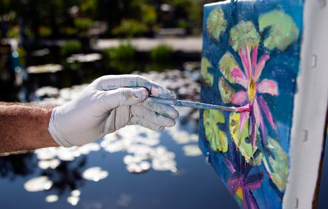 Paul Arsenault adds detail to his painting, Tuesday, March 5, 2019, at the Naples Botanical Garden.