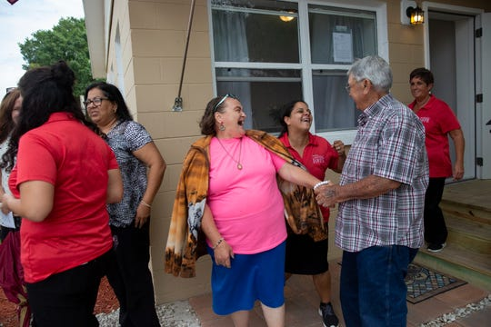 Elizabeth Bishop, center left, and her husband, Earl Bishop, talk with Frances Ribot, center, the disaster case managing supervisor for the Salvation Army, after a ribbon-cutting ceremony Tuesday, March 5, 2019, for the Bishops' restored home in Immokalee.