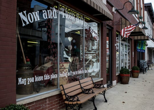 Exterior of  the  antique store, Now and Then & Over Again, Jeff and Debbie Dalzell run in Utica.