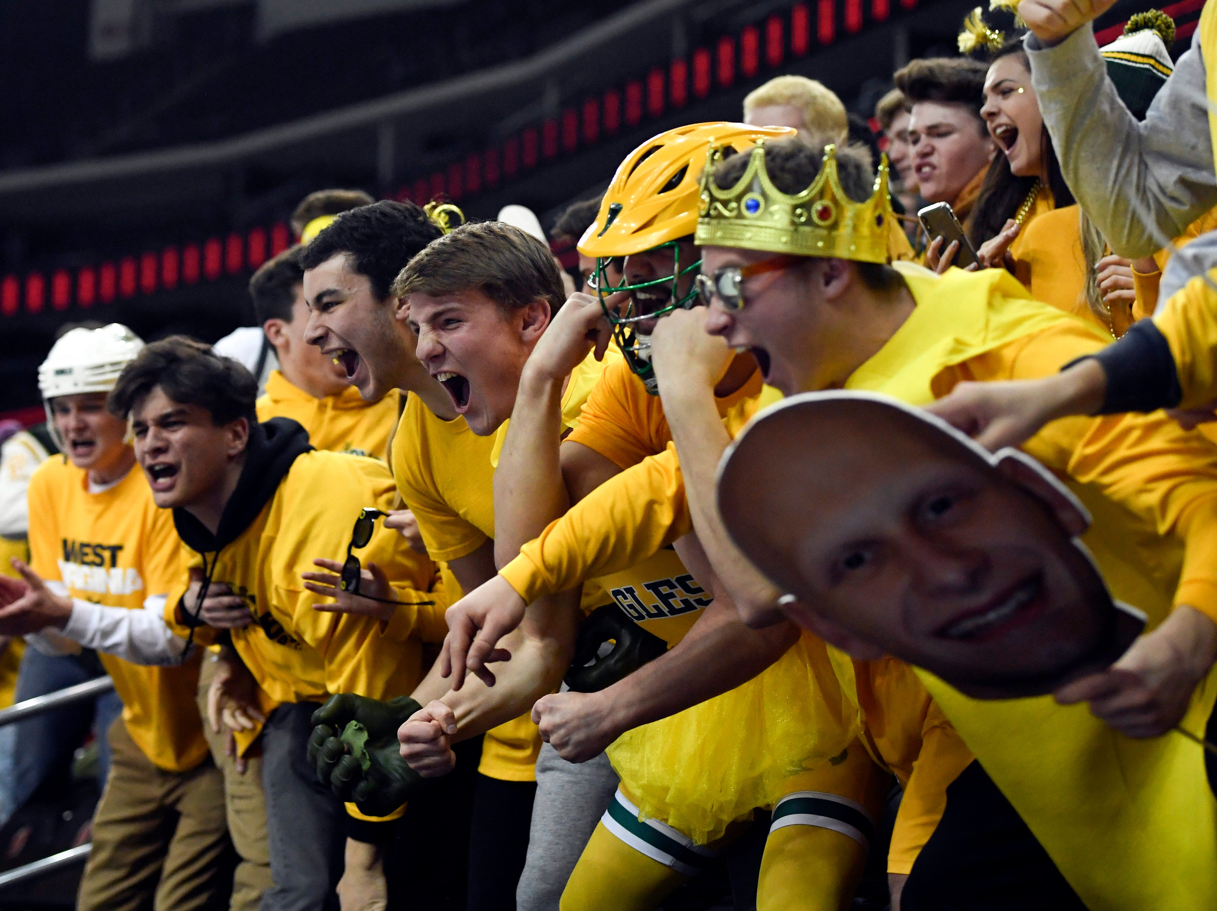Morris Knolls/Hills student section celebrates their first goal of the game against Hillsborough in the Public A ice hockey final at the Prudential Center on Monday, March 4, 2019, in Newark.