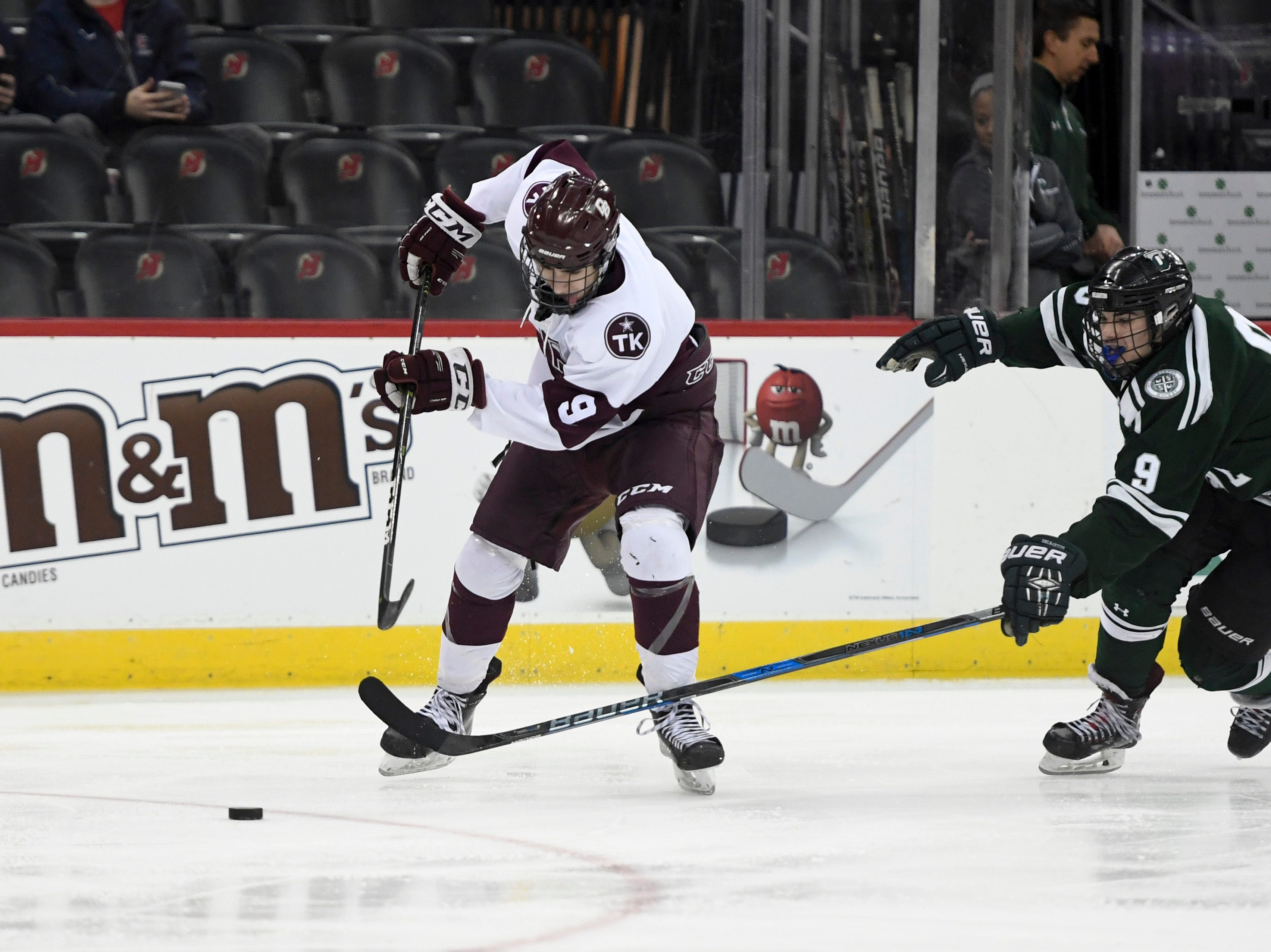 Don Bosco's Damien Carfagna, left, and Delbarton's Michael Balzarotti battle for possession in the second period of the Non-Public ice hockey final at the Prudential Center on Monday, March 4, 2019, in Newark.