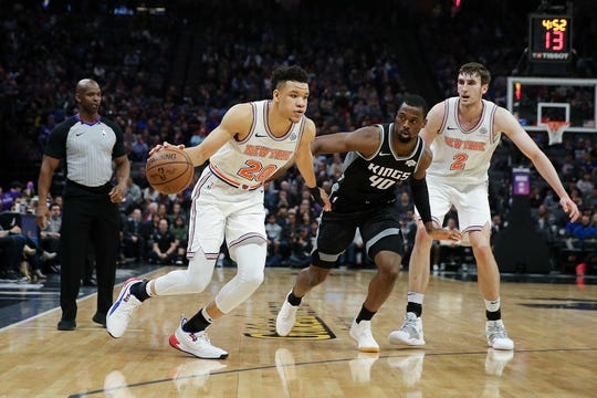 New York Knicks forward Kevin Knox (20) dribbles the ball against Sacramento Kings forward Harrison Barnes (40) during the first quarter at Golden 1 Center.