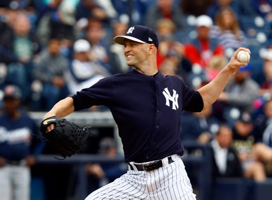 Mar 5, 2019; Tampa, FL, USA; New York Yankees pitcher J.A. Happ (34) throws a pitch during the third inning of a game against the Atlanta Braves at George M. Steinbrenner Field.