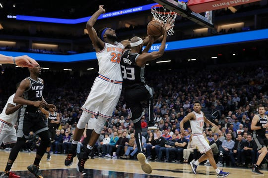 Sacramento Kings guard Corey Brewer (33) is fouled by New York Knicks center Mitchell Robinson (26) during the fourth quarter at Golden 1 Center.