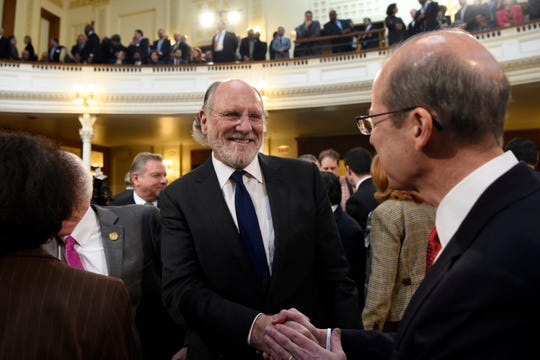 Former Governor Jon Corzine, left, shakes hands with New Jersey Chief Justice Stuart Rabner before the state budget speech on Tuesday, March 5, 2019, in Trenton.