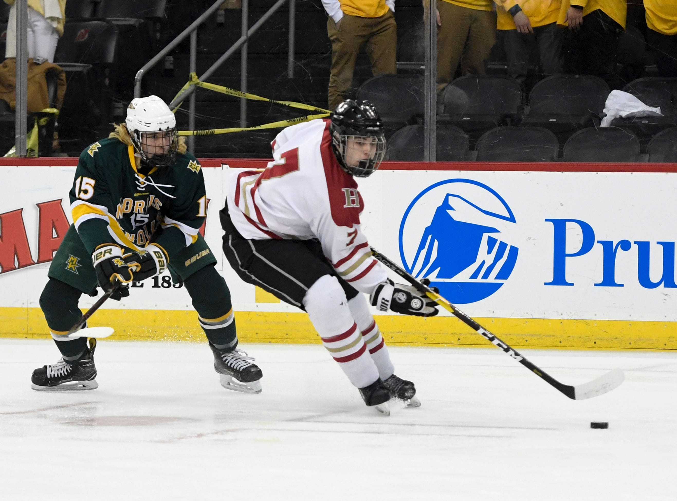 Hillsborough's Robert Renner (7) skates with pressure from Morris Knolls/Hills' Timmy Kepler (15) in the Public A ice hockey final at the Prudential Center on Monday, March 4, 2019, in Newark.